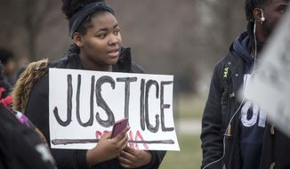 Around 200 to 300 Ball State University students and faculty gather on Tuesday,  Jan. 28, 2020, un Muncie, Ind., to demand change after a professor called the police on a student who refused to move seats in class last week. (Corey Ohlenkamp/The Star Press via AP)