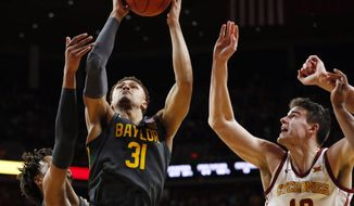 Baylor guard MaCio Teague (31) drives to the basket past Iowa State forward Michael Jacobson (12) during the second half of an NCAA college basketball game Wednesday, Jan. 29, 2020, in Ames, Iowa. Baylor won 67-53. (AP Photo/Charlie Neibergall)