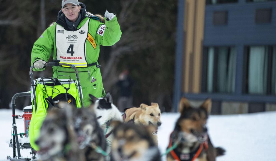 Ryan Redington pumped his fist as he crossed the finish line and officially winning the John Beargrease sled dog marathon on Tuesday, Jan. 28, 2020 in Grand Portage, Minn. Redington has won the John Beargrease Sled Dog Marathon for the second time in three years. (Alex Kormann/Star Tribune via AP)