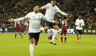 Liverpool's Alex Oxlade-Chamberlain, left, celebrates with Liverpool's Roberto Firmino after scoring his side's second goal during the English Premier League soccer match between West Ham Utd and Liverpool at the London Stadium in London, Wednesday, Jan. 29, 2020. (AP Photo/Frank Augstein)