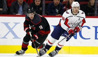 Washington Capitals' John Carlson (74) brings the puck up the ice after taking it from Carolina Hurricanes' Ryan Dzingel (18) during the first period of an NHL hockey game in Raleigh, N.C., Friday, Jan. 3, 2020. (AP Photo/Karl B DeBlaker) ** FILE **