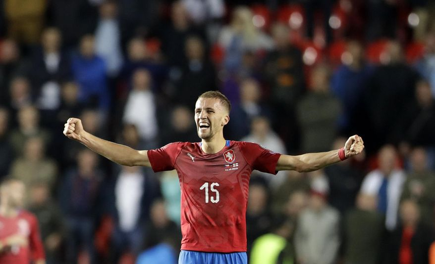 In this file picture taken on Friday, Oct. 11, 2019, Czech Republic's Tomas Soucek celebrates at the end of the Euro 2020 group A qualifying soccer match between Czech Republic and England at the Sinobo stadium in Prague, Czech Republic. Czech Republic midfielder Tomas Soucek has moved from Slavia Prague to English Premier League team West Ham United on loan, according to a club announcement Wednesday Jan. 29, 2020. (AP Photo/Petr David Josek/File)