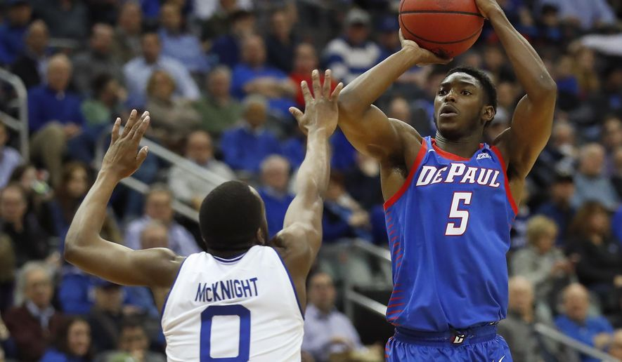 DePaul's Jalen Coleman-Lands (5) takes a jump shot against Seton Hall's Quincy McKnight (0) during the first half of an NCAA college basketball game Wednesday, Jan. 29, 2020, in Newark, N.J. (AP Photo/Noah K. Murray)