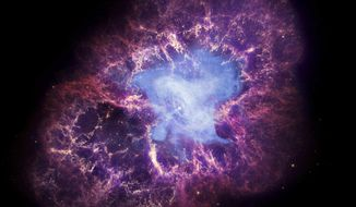 This composite image made available by NASA shows a neutron star, center, left behind by the explosion from the original star's death in the constellation Taurus, observed on Earth as the supernova of A.D. 1054. This image uses data from three of NASA's observatories: the Chandra X-ray image is shown in blue, the Hubble Space Telescope optical image is in red and yellow, and the Spitzer Space Telescope's infrared image is in purple. After nearly two decades in Earth orbit, scanning the universe with infrared eyes, ground controllers plan to put the faltering Spitzer Space Telescope into permanent hibernation on Thursday, Jan. 29, 2020. (X-Ray: NASA/CXC/J.Hester (ASU); Optical: NASA/ESA/J.Hester & A.Loll (ASU); Infrared: NASA/JPL-Caltech/R.Gehrz (Univ. Minn.) via AP)