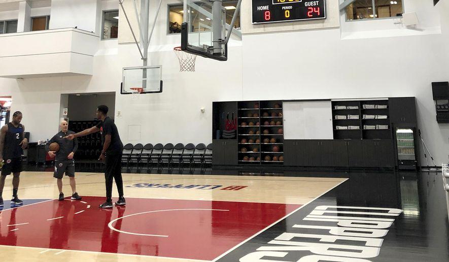 The scoreboard reads 8 and 24 in honor of former Lakers great Kobe Bryant as the Los Angeles Clippers NBA basketball team practices at their training center Wednesday, Jan. 29, 2020, in Los Angeles. (AP Photo/Beth Harris)