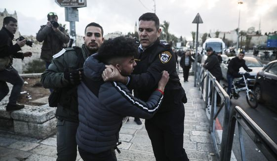 Israeli border police arrests a Palestinian ahead of a protest against Middle East peace plan announced Tuesday by US President Donald Trump, which strongly favors Israel, in Jerusalem, Wednesday, Jan 29, 2020. (AP Photo/Mahmoud Illean)