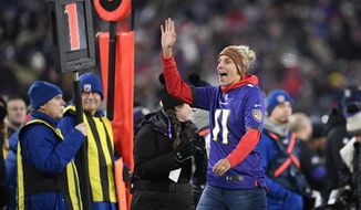 Washington Mystics' Elena Delle Donne, the WNBA league most valuable player, gestures while being honored on the field during the first half of an NFL football game between the Baltimore Ravens and the New York Jets, Thursday, Dec. 12, 2019, in Baltimore. (AP Photo/Nick Wass)