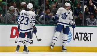 Toronto Maple Leafs center Auston Matthews (34) celebrates his goal against the Dallas Stars with Maple Leafs defenseman Travis Dermott (23) during the first period of an NHL hockey game in Dallas, Wednesday, Jan. 29, 2020. (AP Photo/Michael Ainsworth)