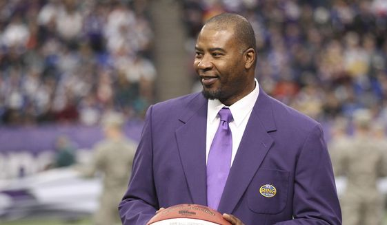In this Dec. 15, 2013, file photo, former Minnesota Viking Chris Doleman acknowledges the crowd during a ceremony honoring the All Mall of America Field team during halftime of an NFL football game between the Vikings and the Philadelphia Eagles in Minneapolis. Hall of Fame defensive end Doleman, who became one of the NFL's most feared pass rushers during 15 seasons in the league, has died. He was 58. The Vikings and Pro Football Hall of Fame president and CEO David Baker offered their condolences in separate statements late Tuesday night, Jan. 29, 2020. (AP Photo/Andy King, File)