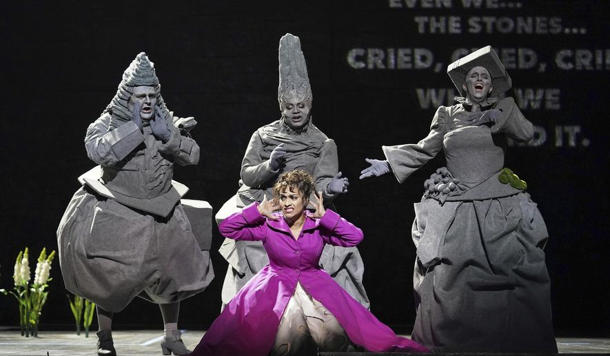 """This Jan. 25, 2020 photo released by the LA Opera shows Danielle de Niese, foreground center, with Kevin Ray, background from left, Raehann Bryce-Davis and Stacey Tappan as the Three Stone sduring a dress rehearsal of """"Eurydice,"""" at the Dorothy Chandler Pavilion in Los Angeles. (Cory Weaver/LA Opera via AP)"""