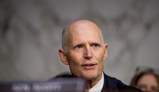 FILE - In this Nov. 5, 2019 file photo, Sen. Rick Scott, R-Fla., questions FBI Director Christopher Wray during a Senate Homeland Security Committee hearing on Capitol Hill in Washington.  Scott injected himself into the 2020 presidential race, airing an ad in Iowa days ahead before the crucial caucus by attacking the Democratic-led impeachment trial against President Donald Trump and accusing former Vice President Joe Biden of corruption. The ad buy by Scott was not just a volley into the current race, but also further signaled his ambitions for 2024 .(AP Photo/Andrew Harnik, File)