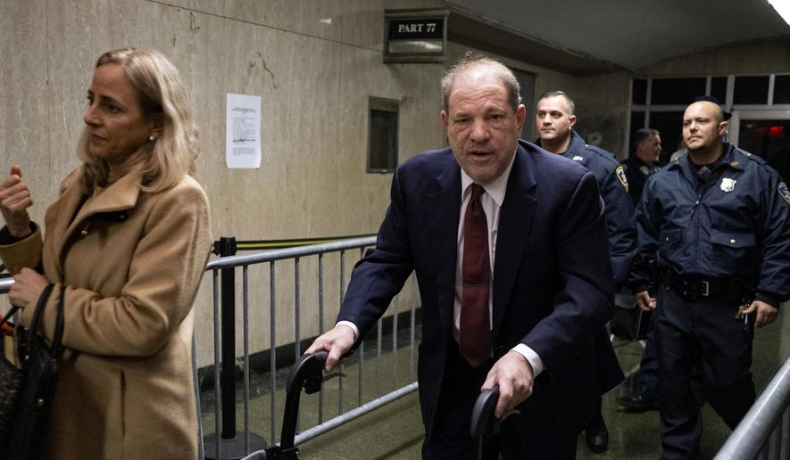 Harvey Weinstein leaves for the day during his trial on charges of rape and sexual assault, Tuesday, Jan. 28, 2020 in New York. (AP Photo/Craig Ruttle)