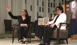 "In this Tuesday, Jan. 28, 2020 photo, Singer Gloria Estefan moderates a presentation with Supreme Court Justice Sonia Sotomayor in Miami. Sotomayor spoke to a crowd about her new book ""Just Ask"". The new illustrated book teaches children and parents how to be better citizens by explaining that acts of civic participation turn people into heroes. (AP Photo/Adriana Gomez Licon)"