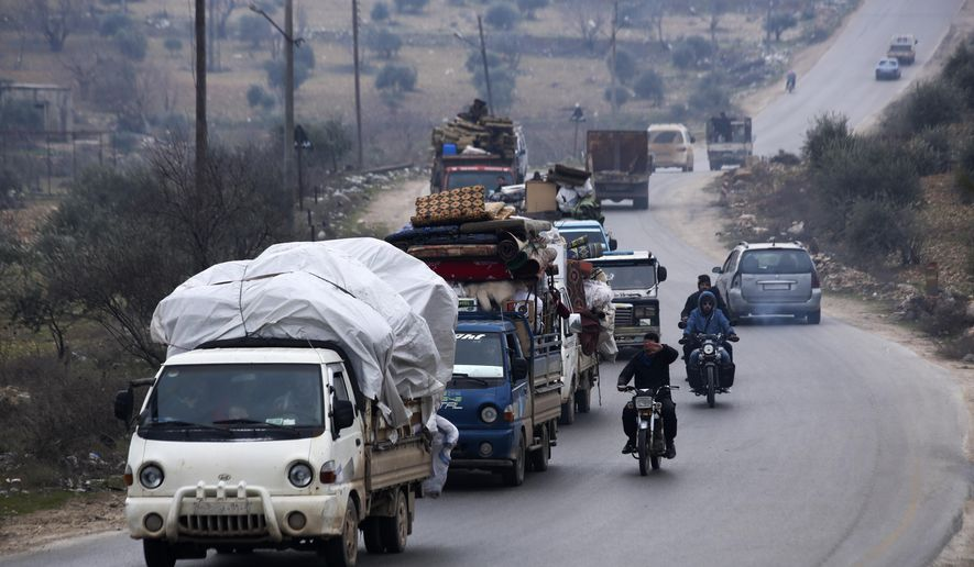 Syrians drive through the city of al-Mastouma, in Idlib province, as they flee a government offensive, Tuesday, Jan. 28, 2020. Syrian government forces have been on the offensive for more than a month in the northwestern Idlib province, the last rebel stronghold in the country. But in recent days, the government captured more than a dozen villages in the area as the insurgents' defenses began to crumble. (AP Photo/Ghaith Alsayed)