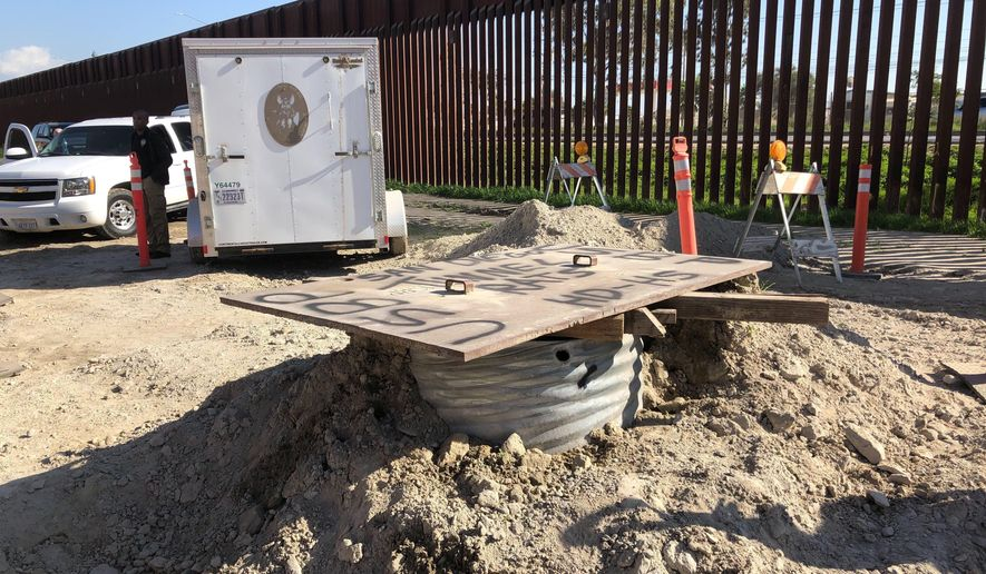A covered access point leading to a smuggling tunnel is seen on the U.S side of the border wall in San Diego, Calif. on Wednesday, Jan. 29, 2020. (AP Photo/Elliot Spagat) ** FILE **