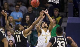 Notre Dame's Prentiss Hubb (3) goes up for a shot between Wake Forest's Torry Johnson (11) and Ody Oguama (33) during the first half of an NCAA college basketball game Wednesday, Jan. 29, 2020, in South Bend, Ind. (AP Photo/Robert Franklin)