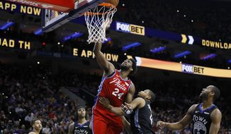 Philadelphia 76ers' Joel Embiid goes up for a shot against Golden State Warriors' Omari Spellman during the second half of an NBA basketball game Tuesday, Jan. 28, 2020, in Philadelphia. (AP Photo/Matt Slocum)