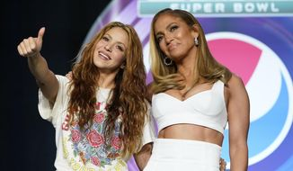 NFL Super Bowl 54 football game halftime performer Jennifer Lopez and Shakira pose for a picture after a news conference Thursday, Jan. 30, 2020, in Miami. (AP Photo/David J. Phillip)