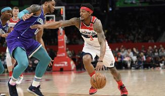 Washington Wizards guard Bradley Beal (3) drives to the basket next to Charlotte Hornets forward Miles Bridges (0) during the second half of an NBA basketball game, Thursday, Jan. 30, 2020, in Washington. (AP Photo/Nick Wass)