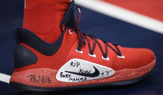 Washington Wizards guard Bradley Beal's shoes pay tribute to the late Kobe Bryant as he warms up before an NBA basketball game against the Charlotte Hornets, Thursday, Jan. 30, 2020, in Washington. (AP Photo/Nick Wass)