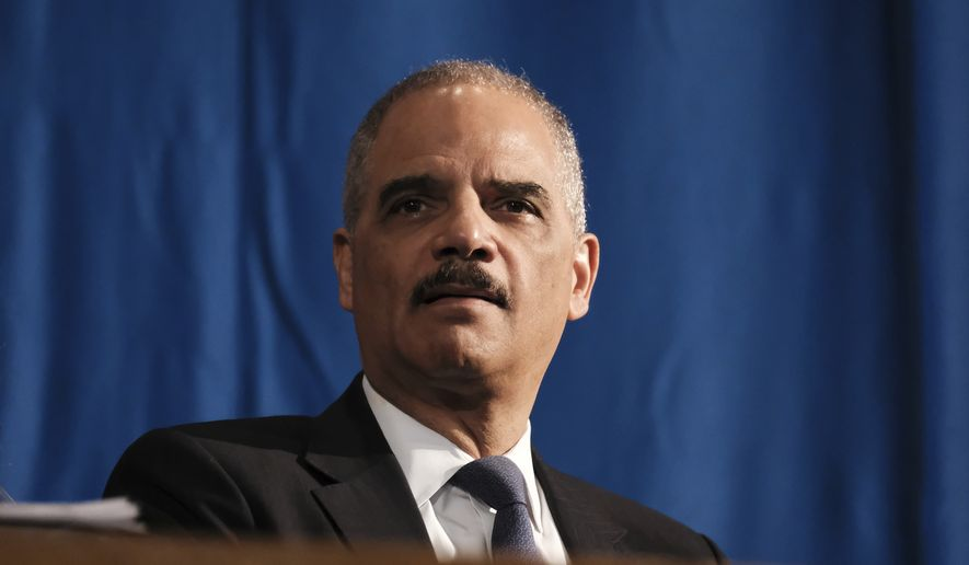 Former Attorney General Eric Holder attends a ceremony to unveil the new Gwen Ifill Black Heritage Commemorative Forever Stamp during a Postal Service ceremony at the Metropolitan African Methodist Episcopal Church, Thursday, Jan. 30, 2020, in Washington. (AP Photo/Michael A. McCoy) **FILE**