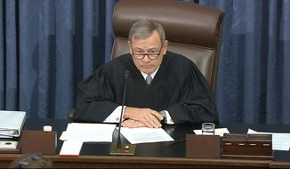In this image from video, presiding officer Chief Justice of the United States John Roberts listens after declining to read a question submitted by Sen. Rand Paul, R-Ky., during the impeachment trial against President Donald Trump in the Senate at the U.S. Capitol in Washington, Thursday, Jan. 30 2020. (Senate Television via AP)