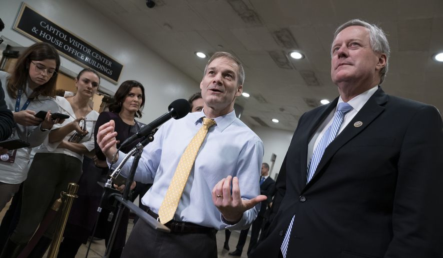Rep. Jim Jordan, R-Ohio, left, joined by  Rep. Mark Meadows, R-N.C., speak with reporters on Capitol Hill during the impeachment trial of President Donald Trump on charges of abuse of power and obstruction of Congress, at the Capitol in Washington, Thursday, Jan. 30, 2020. (AP Photo/J. Scott Applewhite) ** FILE **