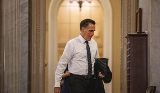 Sen. Mitt Romney, R-Utah, walks to the Senate chamber on Capitol Hill in Washington, Thursday, Jan. 30, 2020, during a break in the impeachment trial of President Donald Trump on charges of abuse of power and obstruction of Congress. (AP Photo/Jacquelyn Martin)