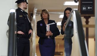 Sen. Lisa Murkowski, R-Alaska, walks in the basement of the U.S. Capitol in Washington, Thursday, Jan. 30, 2020, while leaving at the end of a session in the impeachment trial of President Donald Trump on charges of abuse of power and obstruction of Congress. (AP Photo/Julio Cortez) **FILE**