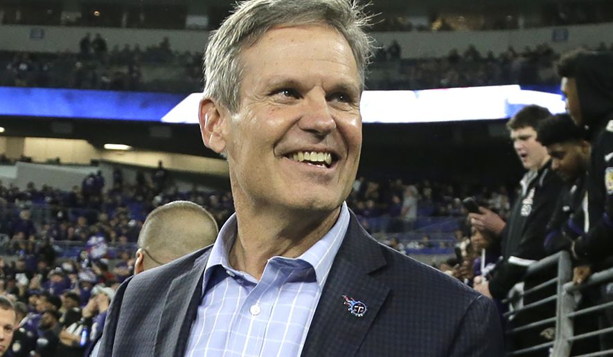 FILE - In this Jan. 11, 2020, file photo, Gov. Bill Lee, R-Tenn., walks on the turf before a NFL divisional playoff football game in Baltimore.  Lee's office sought to downplay potential consequences over an anti-LGBT adoption proposal, multiple big companies reached out to his administration warning the state's reputation would suffer if the Republican were to enact it. Emails obtained through a public records request by The Associated Press show representatives from IKEA, Mars Inc., Nestle USA, Unilever and Danone North America all reached out to Lee's office raising concerns about the proposal's effect on recruiting and retaining employees.  (AP Photo/Julio Cortez, File)