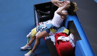 Romania's Simona Halep reacts during her semifinal loss to Spain's Garbine Muguruza at the Australian Open tennis championship in Melbourne, Australia, Thursday, Jan. 30, 2020. (AP Photo/Andy Wong)