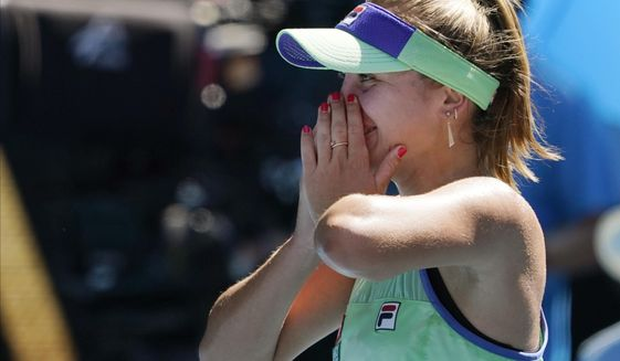 Sofia Kenin of the U.S. celebrates after defeating Australia's Ashleigh Barty in their semifinal match at the Australian Open tennis championship in Melbourne, Australia, Thursday, Jan. 30, 2020. (AP Photo/Lee Jin-man)