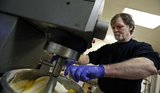 In this March 10, 2014, photo, Masterpiece Cakeshop owner Jack Phillips cracks eggs into a cake batter mixer inside his store in Lakewood, Colo. Phillips' refusal to design a wedding cake for a same-sex couple led to a landmark Supreme Court ruling. (AP Photo/Brennan Linsley) **FILE**