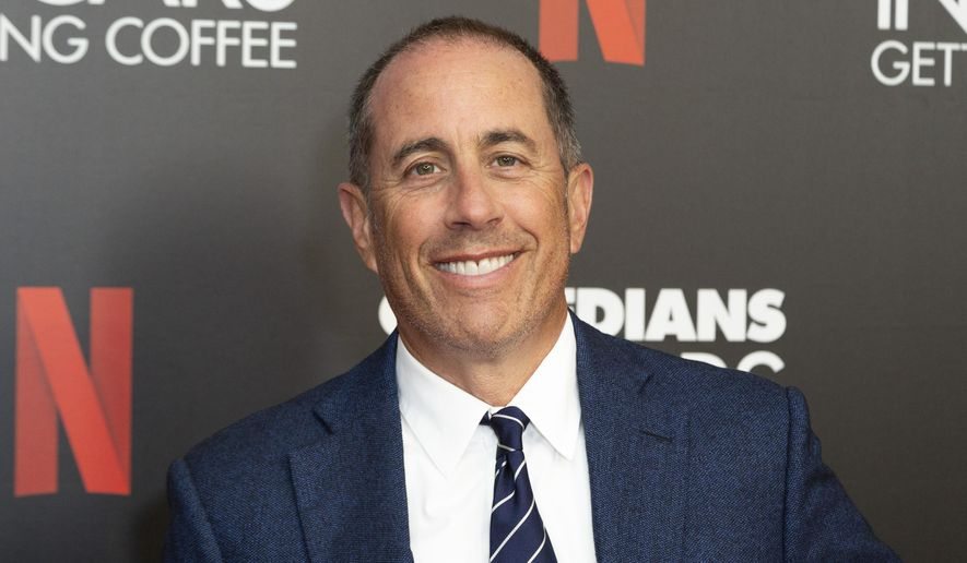 """FILE - This July 17, 2019 file photo shows Jerry Seinfeld at the """"Comedians In Cars Getting Coffee,"""" photo call in Beverly Hills, Calif. Publisher Simon & Schuster announced that Seinfeld will release a book of comedy on October 6. (Photo by Willy Sanjuan/Invision/AP, File)"""