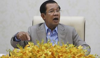 Cambodia's Prime Minister Hun Sen gestures during a speech on the current state of a new virus from China in Phnom Penh, Cambodia, Thursday, Jan. 30, 2020. Cambodia's leader has urged citizens to remain calm about the new virus from China, which has been confirmed in a single case of a visitor from Wuhan. (AP Photo/Heng Sinith)