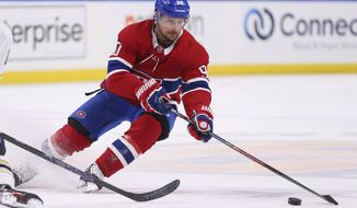 Montreal Canadiens forward Tomas Tatar (90) controls the puck during the first period of the team's NHL hockey game against the Buffalo Sabres, Thursday, Jan. 30, 2020, in Buffalo, N.Y. (AP Photo/Jeffrey T. Barnes)