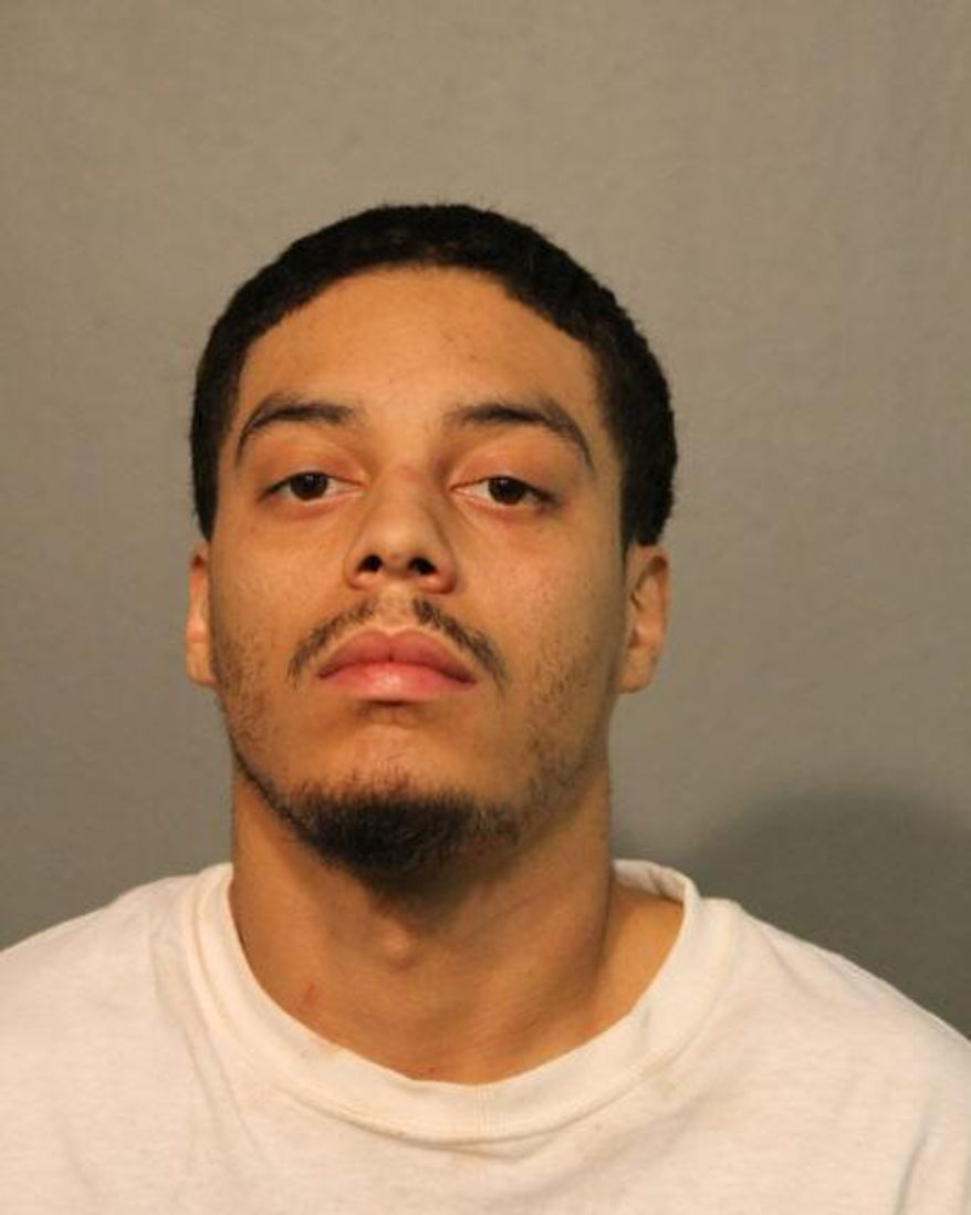 This photo provided by the Chicago police department shows Travis McCoy.  Charges were filed against the parents of a 1-year-old boy who was shot in the head as his parents struggled over a gun inside a Chicago home, police announced Wednesday, Jan. 29, 2020. Travis McCoy, 26, was charged with felony false alarm to 911 and misdemeanor child endangerment. Adriana Smith, 28, is charged with felony obstruction of justice and misdemeanor child endangerment.  (Chicago Police via AP)