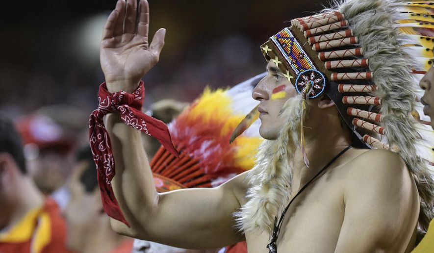 "FILE - In this Oct. 2, 2017, file photo, a Kansas City Chiefs fan does the ""tomahawk chop"" during the second half of an NFL football game in Kansas City, Mo. While other sports teams using Native American nicknames and imagery have faced decades of protests and boycotts, the Chiefs have largely slid under the radar. Vincent Schilling, associate editor of Indian Country Today, said it's time for the Chiefs to face the music. ""When I see something like a tomahawk chop, which is derived from television and film portrayals, I find it incredibly offensive because it is an absolutely horrible stereotype of what a native person is."" (AP Photo/Reed Hoffmann, File)"