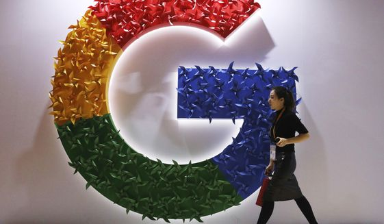 "FILE - In this Monday, Nov. 5, 2018, file photo, a woman walks past the logo for Google at the China International Import Expo in Shanghai. Chinese tech giant Huawei is racing to develop replacements for Google apps. U.S. sanctions imposed on security grounds block Huawei from using YouTube and other popular Google ""core apps."" (AP Photo/Ng Han Guan, File)"