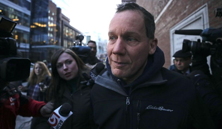 Harvard University professor Charles Lieber is surrounded by reporters as he leaves the Moakley Federal Courthouse in Boston, Thursday, Jan. 30, 2020. Leiber, chair of the department of chemistry and chemical biology, with lying to officials about his involvement with a Chinese government-run recruitment program through which he received tens of thousands of dollars. (AP Photo/Charles Krupa)