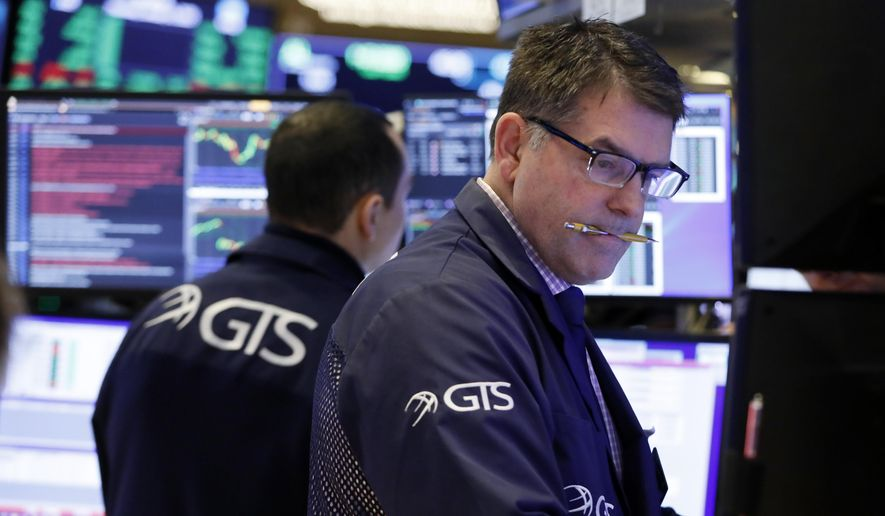 FILE - In this Jan. 9, 2020, file photo specialist David Haubner works on the floor of the New York Stock Exchange. The U.S. stock market opens at 9:30 a.m. EST on Thursday, Jan. 30. (AP Photo/Richard Drew, File)