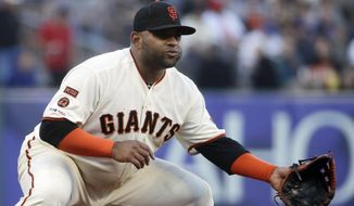 FILE - In this July 22, 2019, file photo, San Francisco Giants third baseman Pablo Sandoval get set during a baseball game against the Chicago Cubs in San Francisco. The 33-year-old Sandoval is working back from season-ending Tommy John reconstructive surgery on his right elbow. (AP Photo/Jeff Chiu, File)