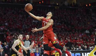 Maryland guard Anthony Cowan Jr. (1) goes to the basket for a layup during the second half of the team's NCAA college basketball game against Iowa on Thursday, Jan. 30, 2020, in College Park, Md. (AP Photo/Terrance Williams)