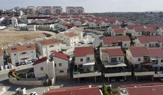 FILE - This Jan. 28, 2020 file photo shows a view of the Jewish West Bank settlement of Ari'el. Israel has vowed to quickly annex large parts of the occupied West Bank after being given a green light by President Donald Trump, whose newly unveiled Mideast initiative heavily favors Israel and has been rejected by the Palestinians. But the move raises complex legal questions. (AP Photo/Ariel Schalit, File