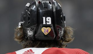 Los Angeles Kings left wing Alex Iafallo wears a sticker on his helmet honoring Kobe Bryant and his daughter Gigi before an NHL hockey game against the Tampa Bay Lightning, Wednesday, Jan. 29, 2020, in Los Angeles. All the Kings players wore the stickers on their helmets. (AP Photo/Michael Owen Baker)