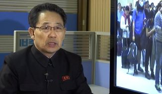 In this image made from video, North Korea's Ministry of Health Director Kim Dong Gun talks about the country's efforts to contain the spread of the new coronavirus, at the Ministry of Health Thursday, Jan. 30, 2020, in Pyongyang, North Korea. Kim says the country is intensifying efforts to prevent the spread of a new virus from China into the isolated country by blocking tourists, reducing flights and mobilizing screening efforts. (AP Photo)