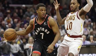 Toronto Raptors' Kyle Lowry (7) drives past Cleveland Cavaliers' Darius Garland (10) during the second half of an NBA basketball game Thursday, Jan. 30, 2020, in Cleveland. Toronto won 115-109. (AP Photo/Tony Dejak)