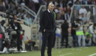 Real Madrid's head coach Zinedine Zidane looks on his team during the Spanish Super Cup Final soccer match between Real Madrid and Atletico Madrid at King Abdullah stadium in Jiddah, Saudi Arabia, Sunday, Jan. 12, 2020. (AP Photo/Hassan Ammar)