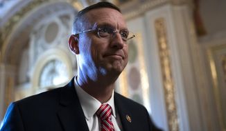 Rep. Doug Collins, R-Ga, the ranking member of the House Judiciary Committee, emerges from a conference room working with other allies of President Donald Trump during his impeachment trial, at the Capitol in Washington, Wednesday, Jan. 29, 2020. Collins announced Wednesday that he's running for the U.S. Senate seat held by a fellow Republican sworn in just weeks ago, GOP Sen. Kelly Loeffler. (AP Photo/J. Scott Applewhite)