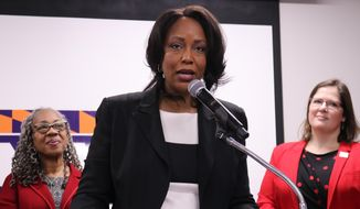 In this Jan. 27, 2020, photo, Maya Rockeymoore Cummings, who is running for her late husband's congressional seat in a special primary in Maryland, speaks at a news conference in Baltimore, Md. Emily Cain, executive director of EMILY's List, is standing right. Helen Holton, a former Baltimore City Councilwoman, is standing left. AP Photo/Brian Witte)